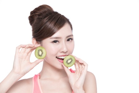 kiwi: Beauty woman and Kiwi fruit - The woman is dieting healthy isolated on the white background, asian female
