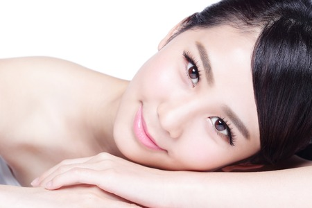 Charming woman face Smile to you close up while lying isolated on white background, asian girl 版權商用圖片
