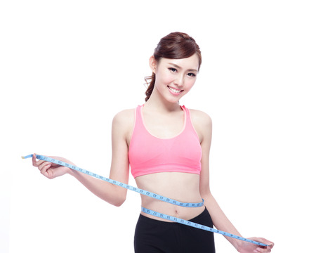 body shape: Health concept, Sport girl hold measure tape isolated on white background. asian beauty
