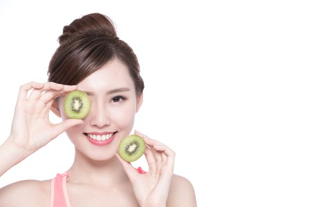 female beauty: Beauty woman and Kiwi fruit - The woman is dieting healthy isolated on the white background, asian female