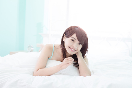 girl home: Charming woman Smile face close up and she lying on the bed in the morning , asian girl Stock Photo