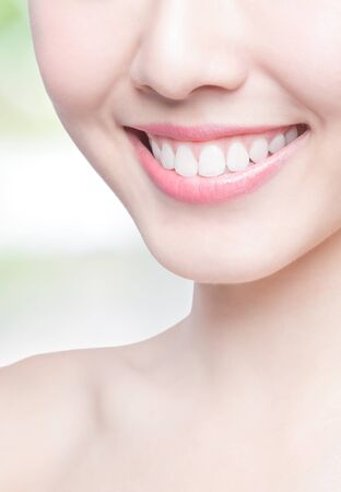 smile close up: Beautiful young woman health teeth close up and charming smile with green background, asian beauty