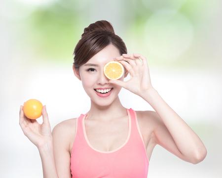 health beauty: Happy Woman show orange benefit to health, asian beauty