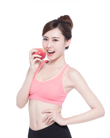 vitality: Happy health woman show apple benefit to health, asian beauty