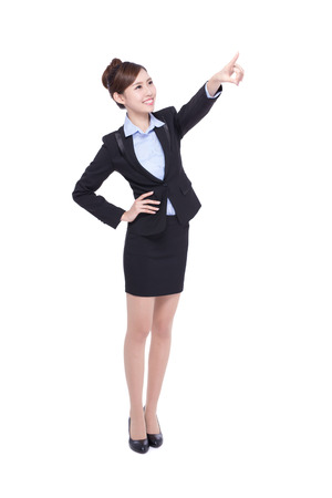 professional people: business woman pointing isolated on white background, asian beauty