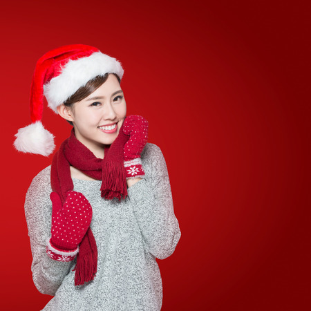 happy shopping: Happy Christmas Woman isolated on red background, asian Stock Photo