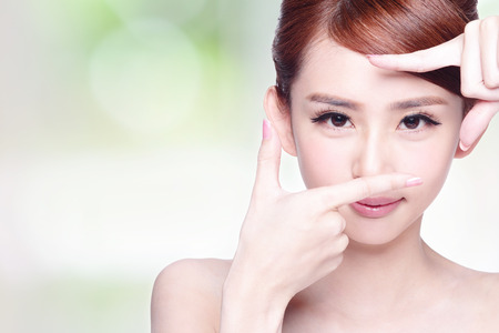 woman face close up: Woman face and eye care and she making frame with hands, asian beauty Stock Photo