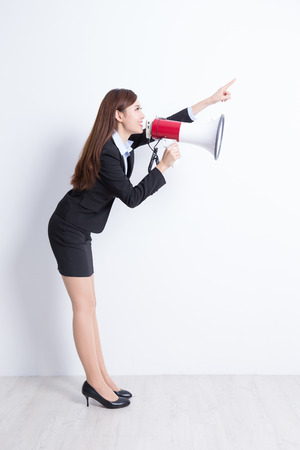 talk show: business woman talking in megaphone with white wall background, great for your design or text, asian Stock Photo