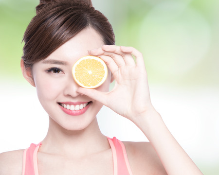 asian food: Happy Woman show orange benefit to health, asian beauty