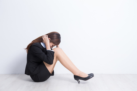 business woman feel unhappy with white wall background, great for your design or text, asian