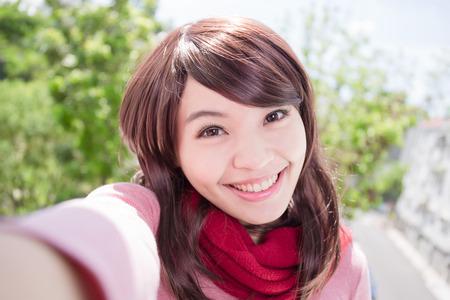 Young beautiful woman wearing winter clothing and photo selfie, asian beauty Stock Photo