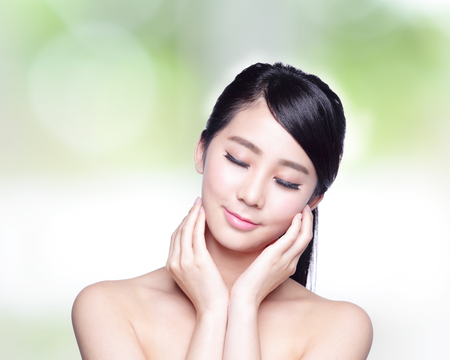 skin care woman: Beautiful Skin care woman Face smile and enjoy carefree isolated on nature green background. asian Beauty Stock Photo