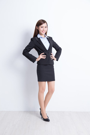 asian businesswoman: business woman stand with white wall background, great for your design or text, asian