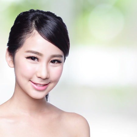 healthcare and beauty: beautiful woman with health teeth smile to you with nature green background. asian Beauty