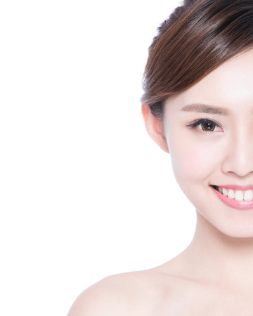 half body: Half portrait of the woman with beauty face, perfect skin and health teeth, she smile to you isolated on white background, asian beauty