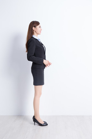 profile: business woman stand profile with white wall background, great for your design or text, asian Stock Photo