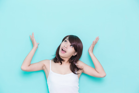 girl home: young woman think something isolated on green background, asian beauty