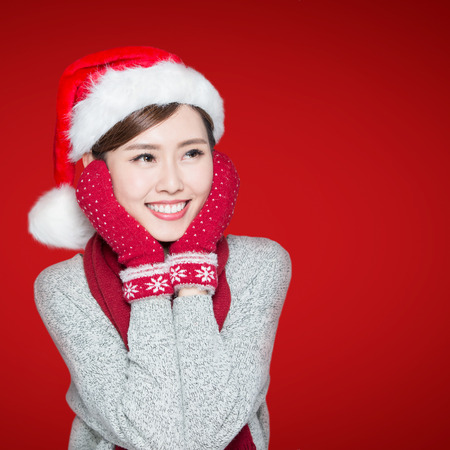 christmas woman: Happy Christmas  beauty woman isolated on red background, asian