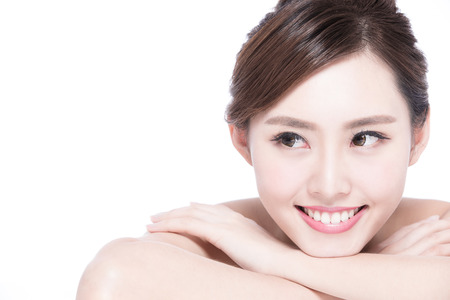 white teeth: Charming woman face Smile to you close up while lying isolated on white background, asian girl Stock Photo