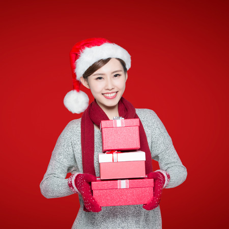 asian lady: Happy woman is delivering Christmas gifts, asian Stock Photo
