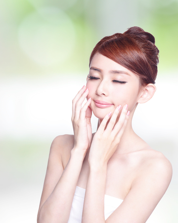 beauty and health: Beautiful Skin care woman enjoy and relax isolated on nature green background. asian Beauty Stock Photo