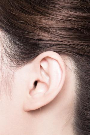 oido: Cerca de la mujer oído. Belleza asiática Foto de archivo