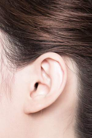 a close up: close up of woman ear. asian Beauty