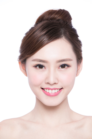 woman face close up: Beautiful Skin care woman Face smile to you isolated on white background. asian Beauty Stock Photo