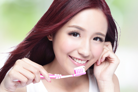 smile close up: Close up of Smile woman brush teeth. great for health dental care concept, with nature green background. asian Stock Photo