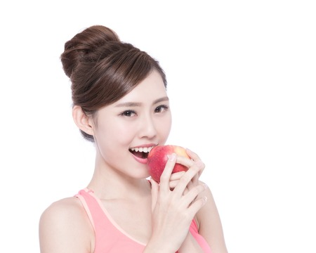 lady in red: Happy health woman show apple benefit to health, asian beauty