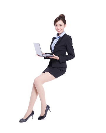 young worker: business woman sit with laptop computer isolated on white background, asian beauty