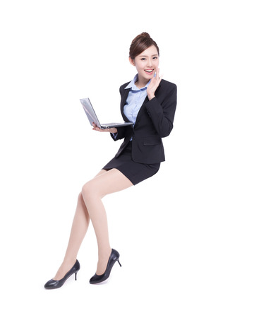 woman shouting: business woman sit and shout to you with laptop computer isolated on white background, asian beauty Stock Photo