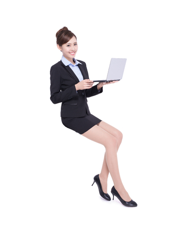 woman work: business woman sit with laptop computer isolated on white background, asian beauty