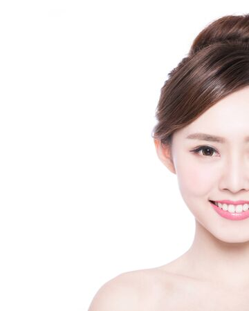 half: Half portrait of the woman with beauty face, perfect skin and health teeth, she smile to you isolated on white background, asian beauty