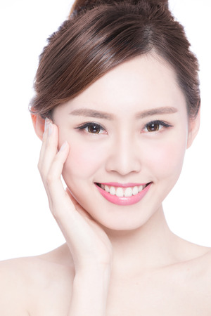 Beautiful Skin care woman Face smile to you isolated on white background. asian Beauty Stock Photo