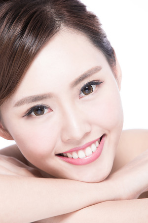 body expression: Charming woman face Smile to you close up while lying isolated on white background, asian girl Stock Photo