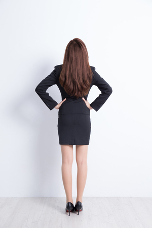 asian lady: Back view of business woman look white wall background, great for your design or text, asian Stock Photo