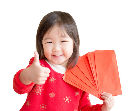 red envelope: happy chinese new year. smile asian girl show thumb up with red envelope isolated on white background