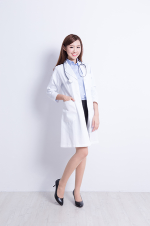 Smiling medical doctor woman with stethoscope. with white wall background. asian Stock Photo