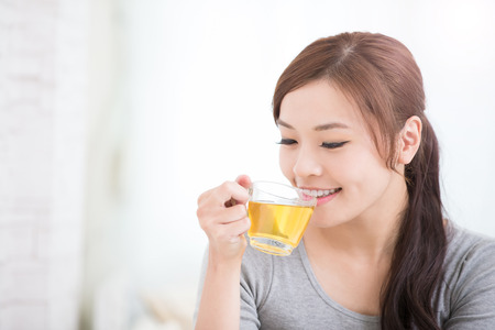 smile young woman holding cup of  green tea at home, healthy lifestyle concept, asian beauty, asian beauty Banco de Imagens