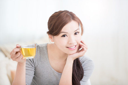 tea table: smile young woman holding cup of  green tea at home, healthy lifestyle concept, asian beauty, asian beauty Stock Photo