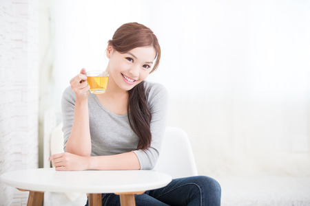 see: smile young woman holding cup of  green tea at home, healthy lifestyle concept, asian beauty, asian beauty Stock Photo
