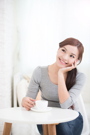 young woman sitting: smile young woman holding cup of coffee or tea at home, healthy lifestyle concept, asian beauty, asian beauty