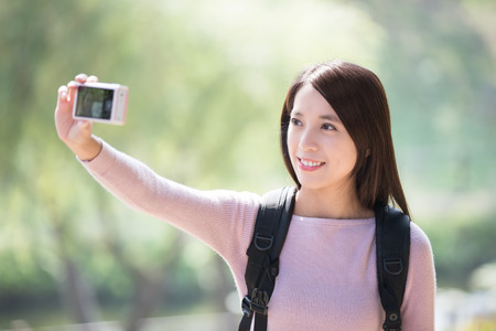 young asian: young woman traveler happy smile take selfie. nature green background, asian beauty Stock Photo