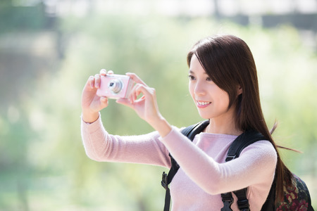 young woman traveler happy smile take selfie. nature green background, asian beauty 스톡 콘텐츠