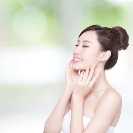 nature beauty: Beautiful Skin care woman enjoy and relax with green background. asian Beauty Stock Photo