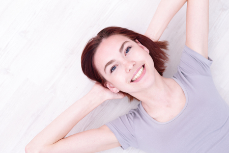 the caucasian beauty: Close up portrait of a Happy young beautiful woman relax lying and smile to you, caucasian beauty Stock Photo