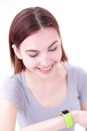 the caucasian beauty: Happy young smile woman look smart watch and relax sit, caucasian beauty