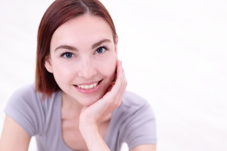 the caucasian beauty: Close up portrait of a Happy young beautiful woman relaxing and sitting, caucasian beauty Stock Photo