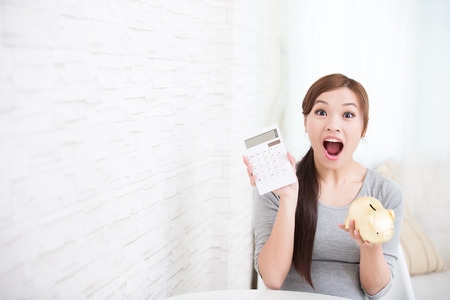smile young woman hold calculator and piggy bank at home, business concept, asian beauty Imagens - 53518893
